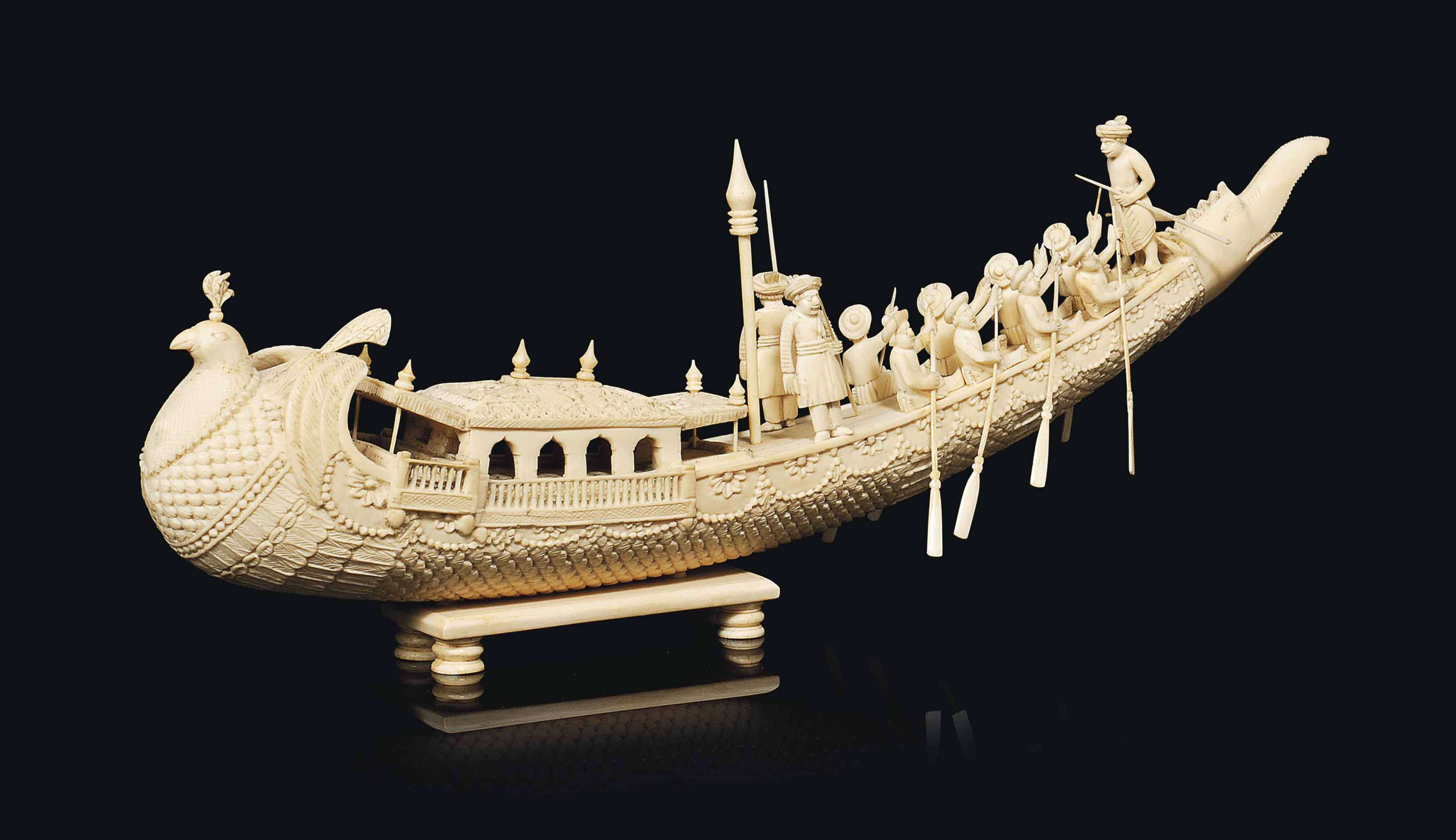 AN INDIAN IVORY CARVED MODEL O
