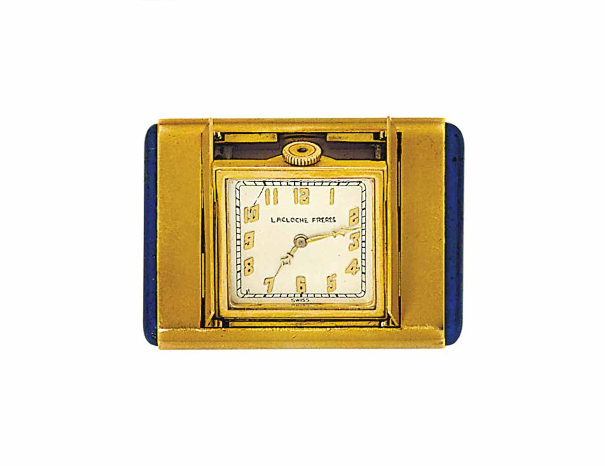 A lapis lazuli and gold purse watch, by Lacloche Frères