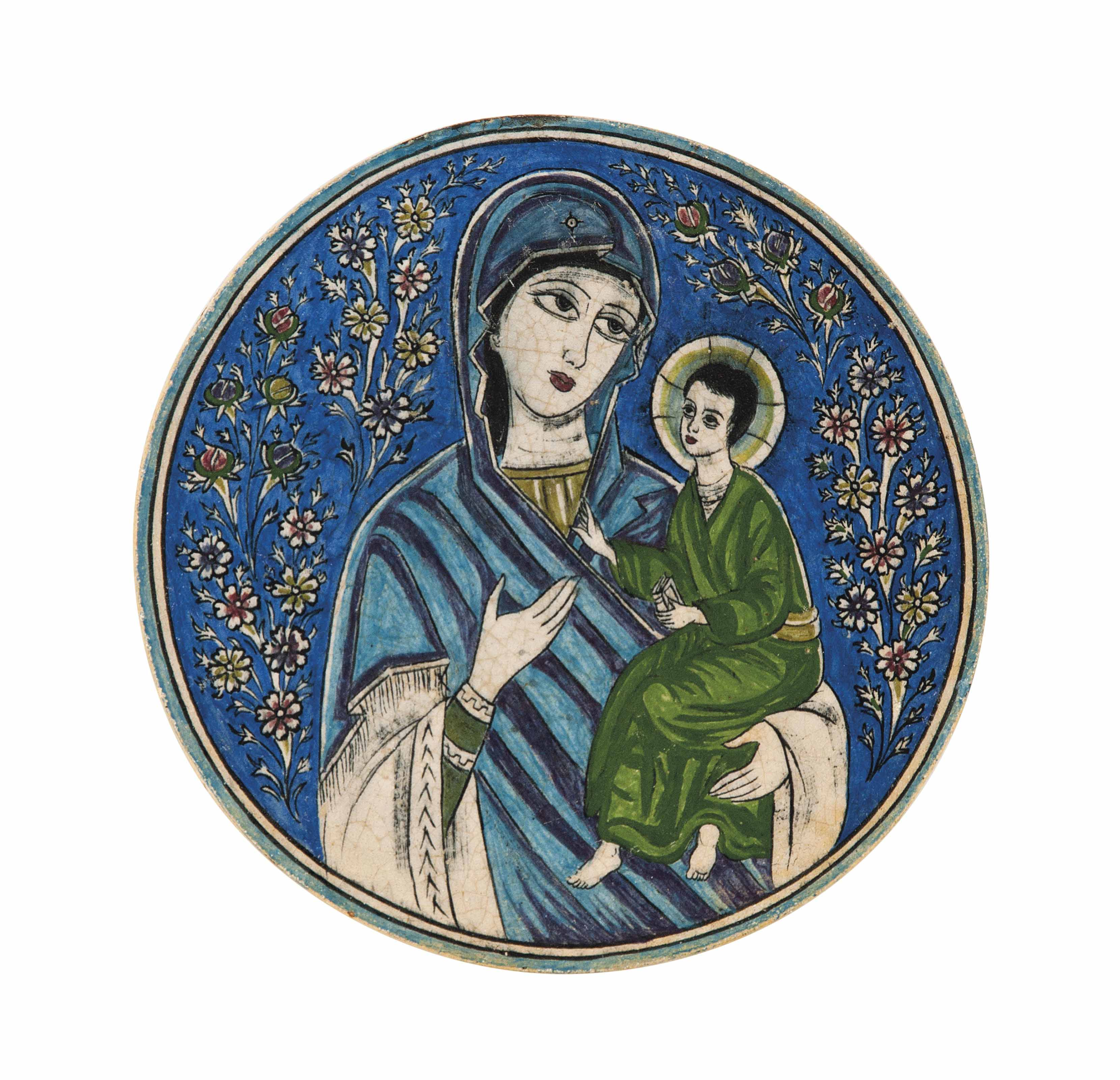 A CIRCULAR POTTERY TILE DEPICTING THE VIRGIN MARY AND CHILD