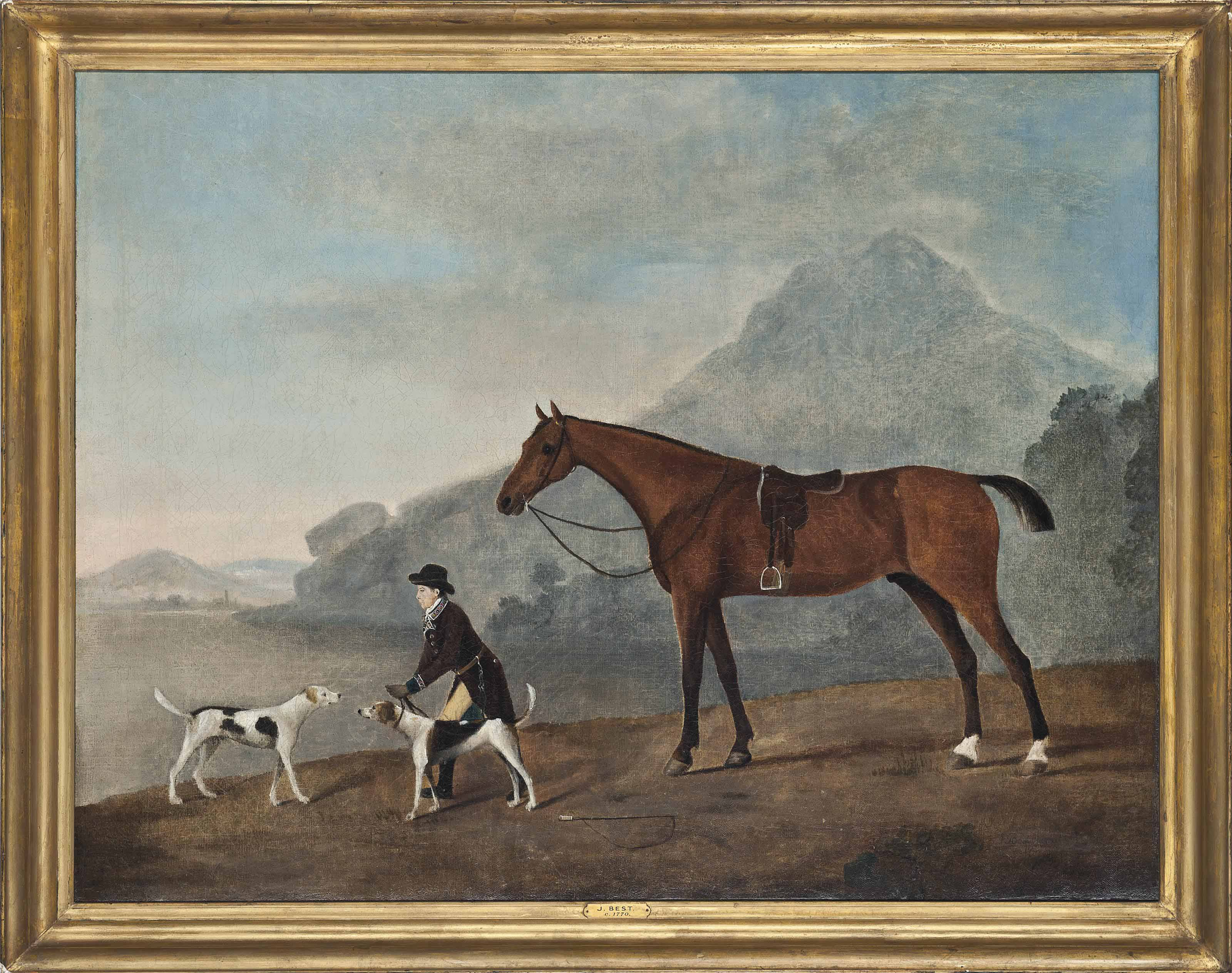 A hunstman with two hounds, with his horse, in a mountainous landscape