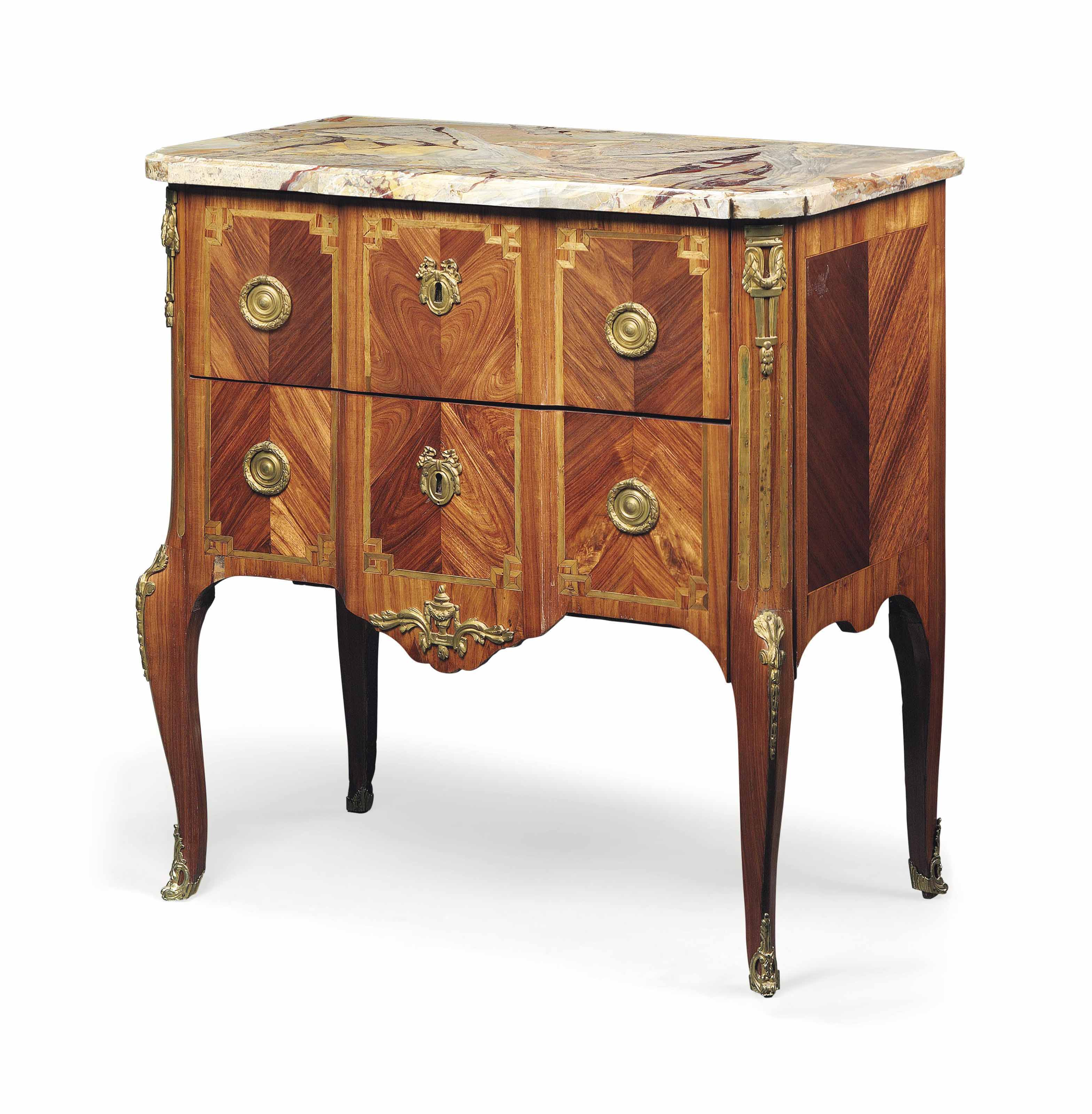 A LATE LOUIS XV ORMOLU-MOUNTED TULIPWOOD AND MARQUETRY COMMODE