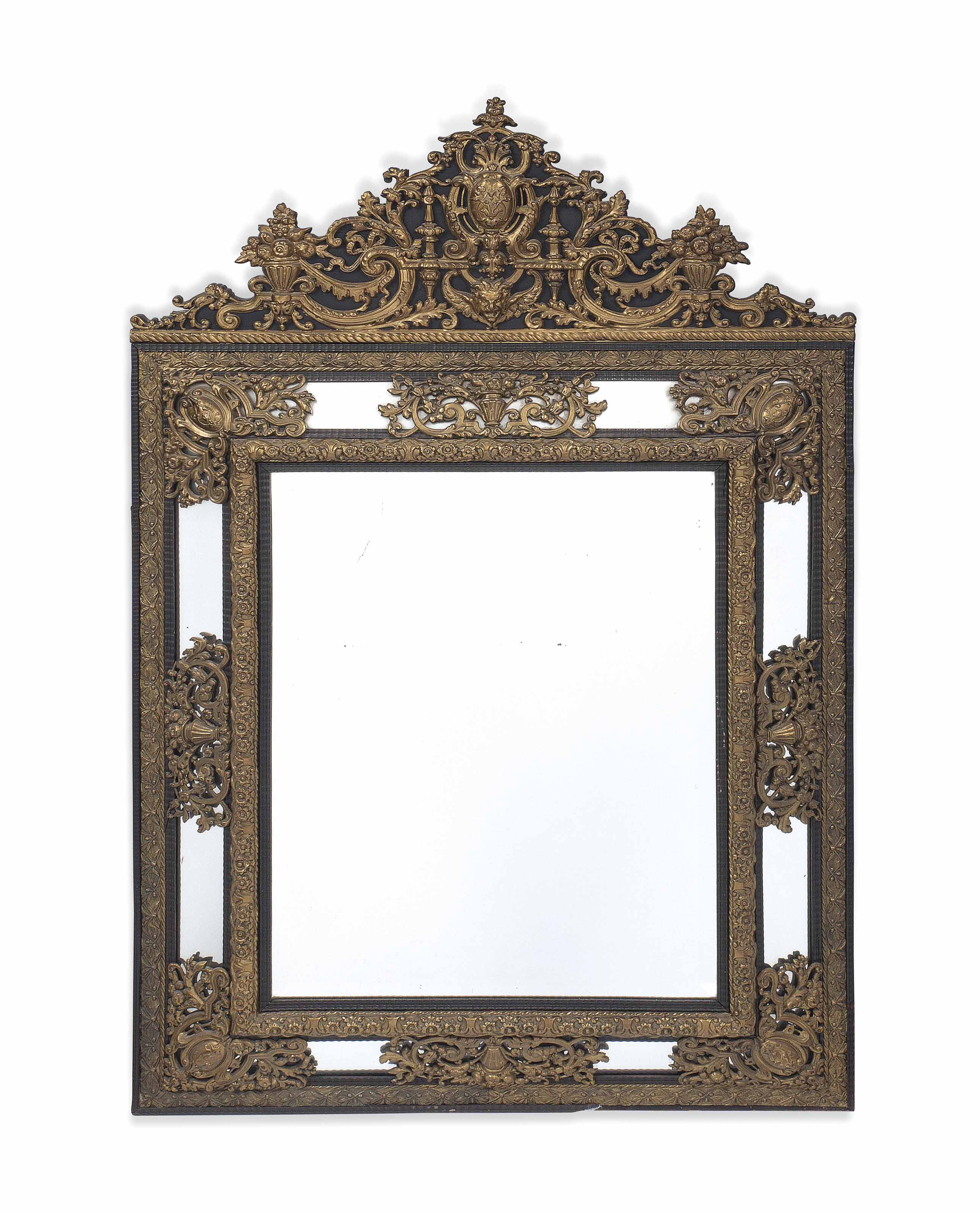 A LARGE DUTCH EBONISED AND REPOUSSE GILT-METAL MIRROR
