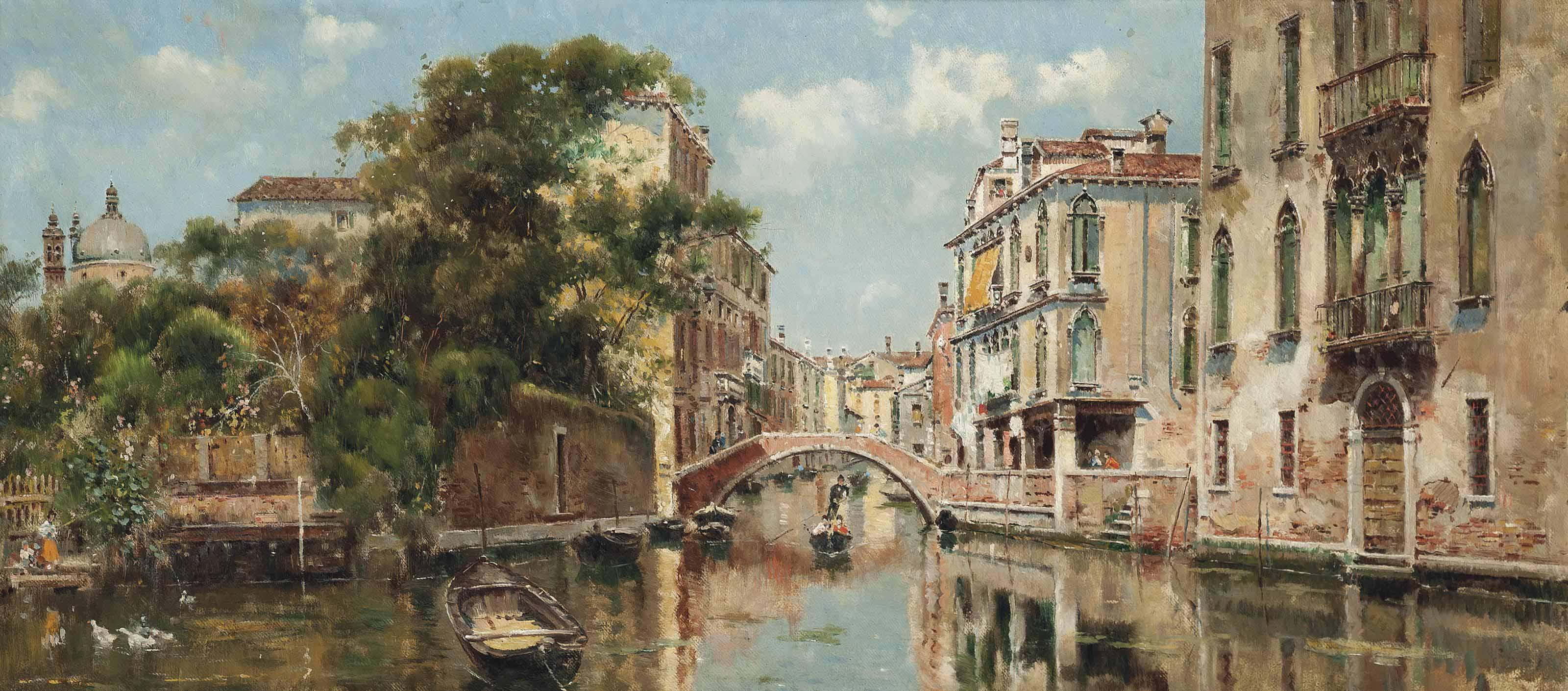 A gondolier before a Venetian bridge
