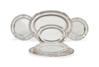 A GRADUATED SET OF TEN WILLIAM IV/EARLY VICTORIAN SILVER MEAT DISHES AND PLATES