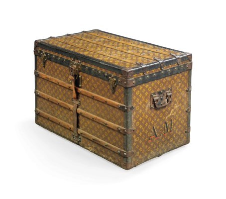 A LOW TRUNK IN MONOGRAM CANVAS