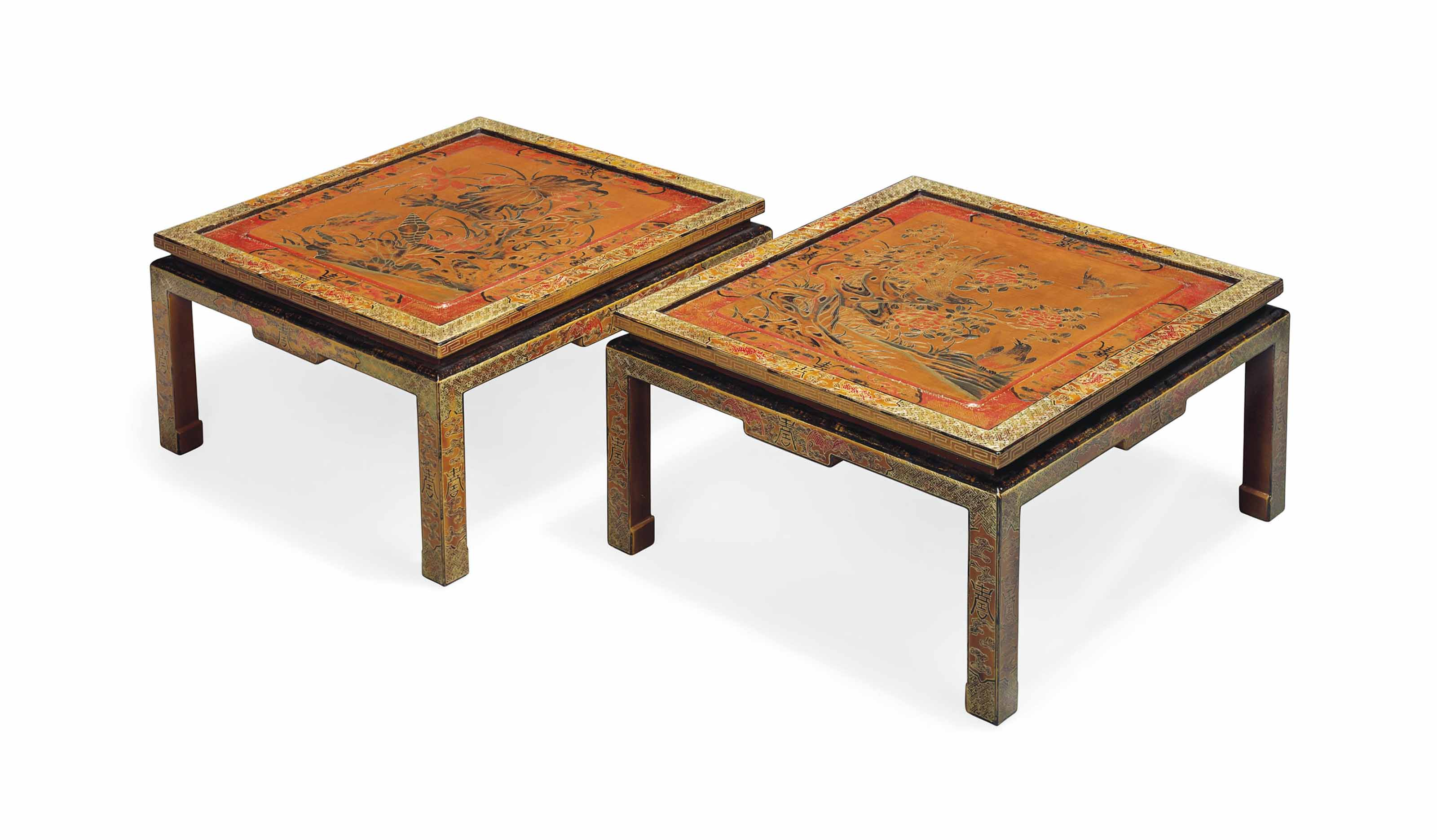 A PAIR OF RED, BLACK AND GILT LACQUER DECORATED LOW TABLES