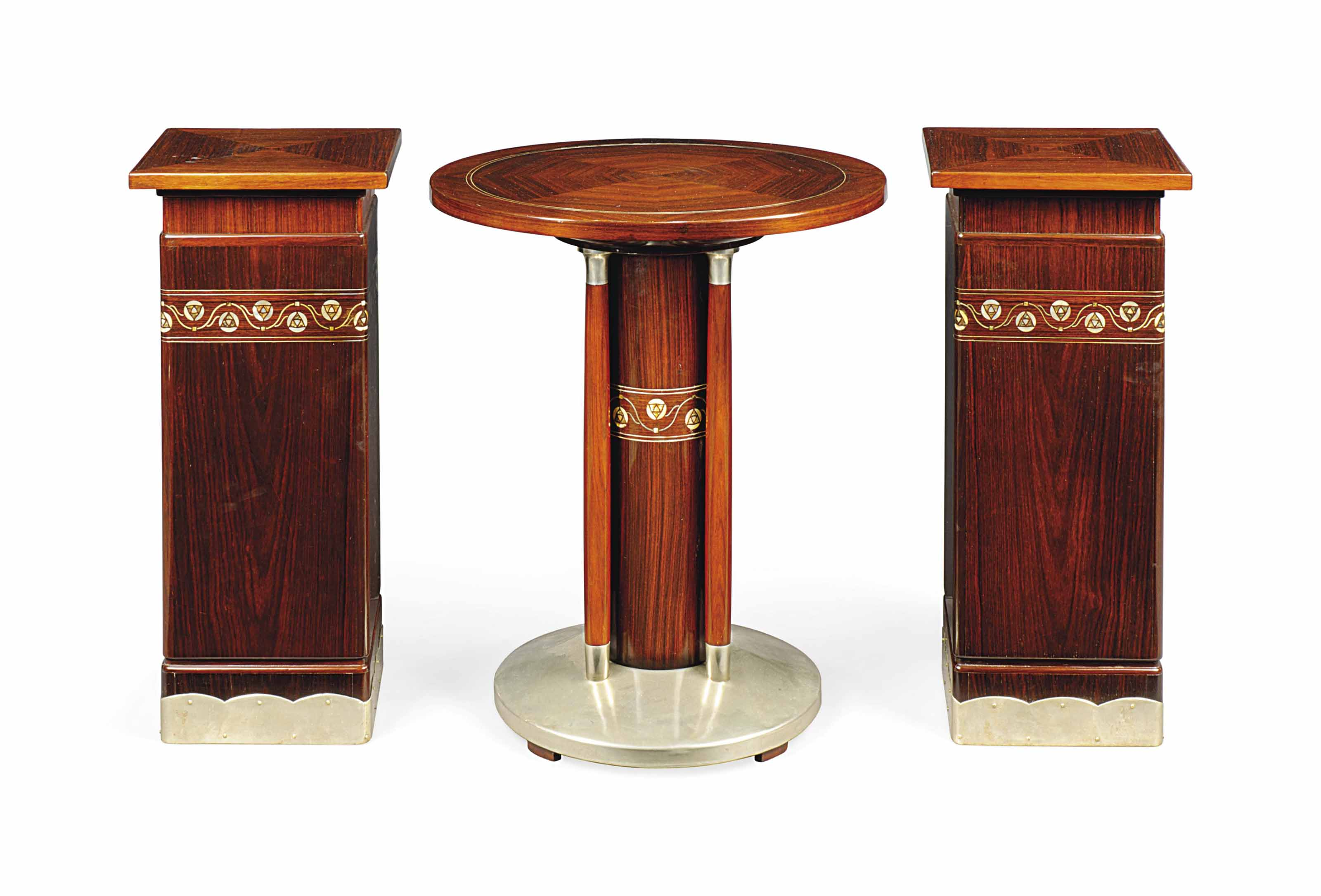 A MACASSAR AND ABALONE-INLAID OCCASIONAL TABLE AND A PAIR OF MATCHING PEDESTALS IN THE STYLE OF JOSEF M. OLBRICH (1867-1908)