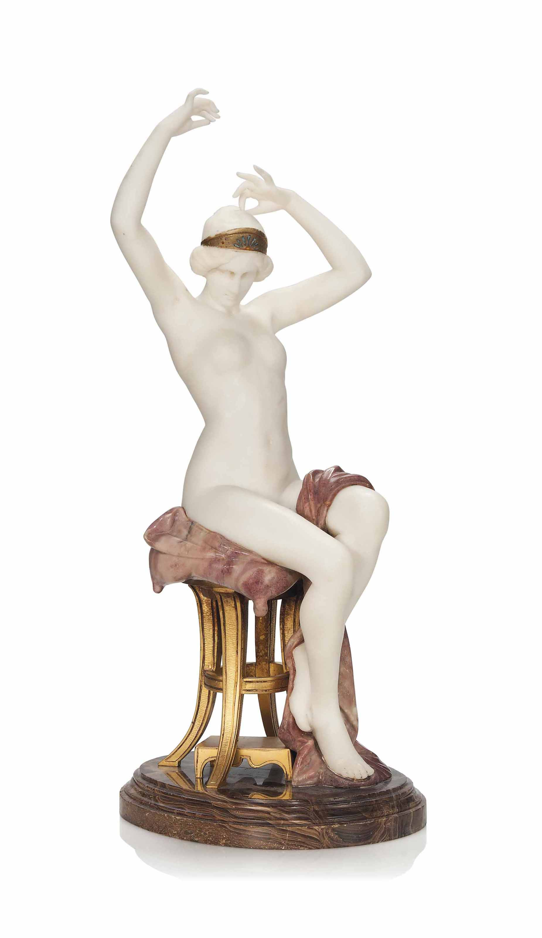'THE BATHER' A CARVED PINK AND