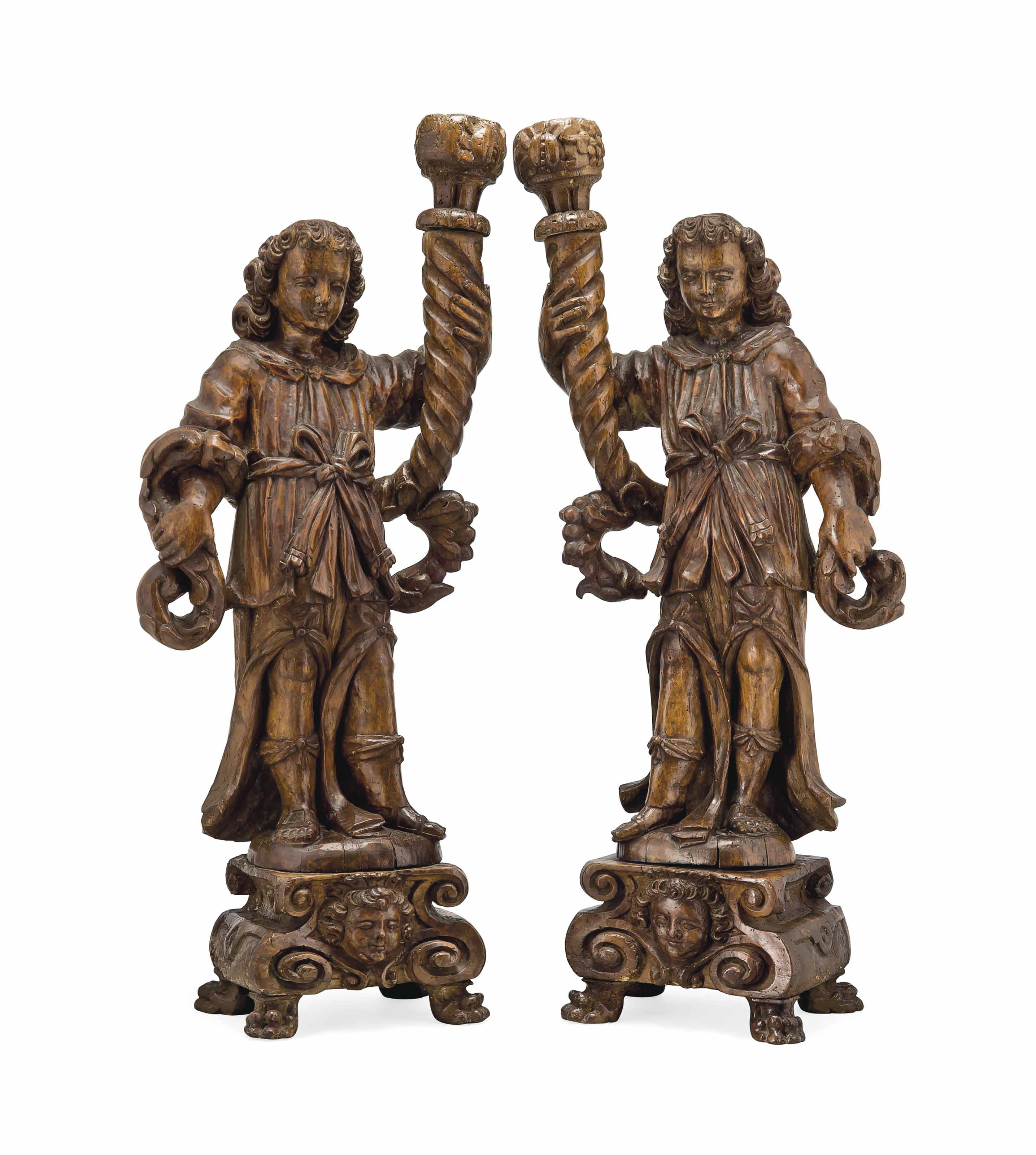 A PAIR OF ITALIAN CARVED WALNU