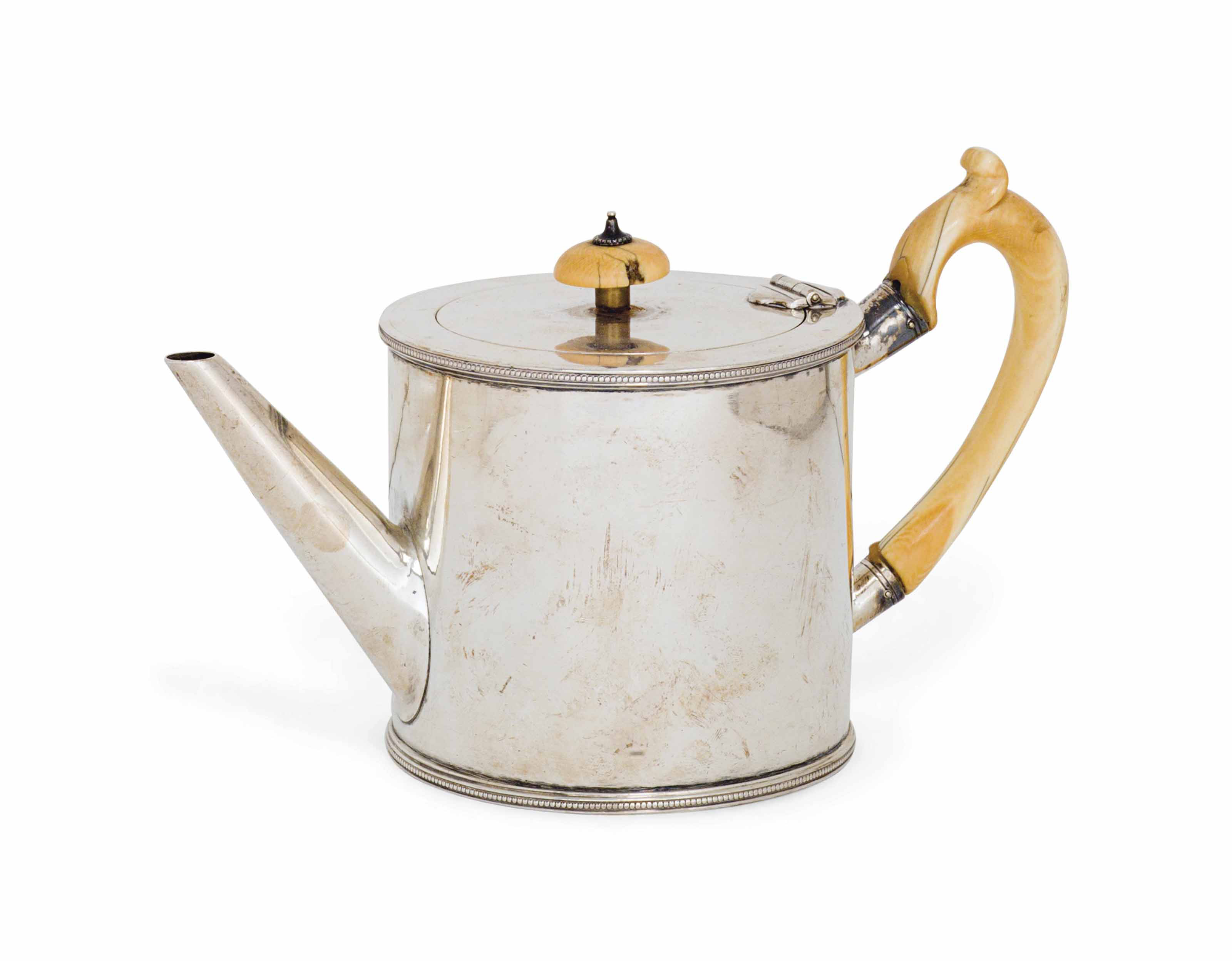A GEORGE III SILVER DRUM TEAPOT