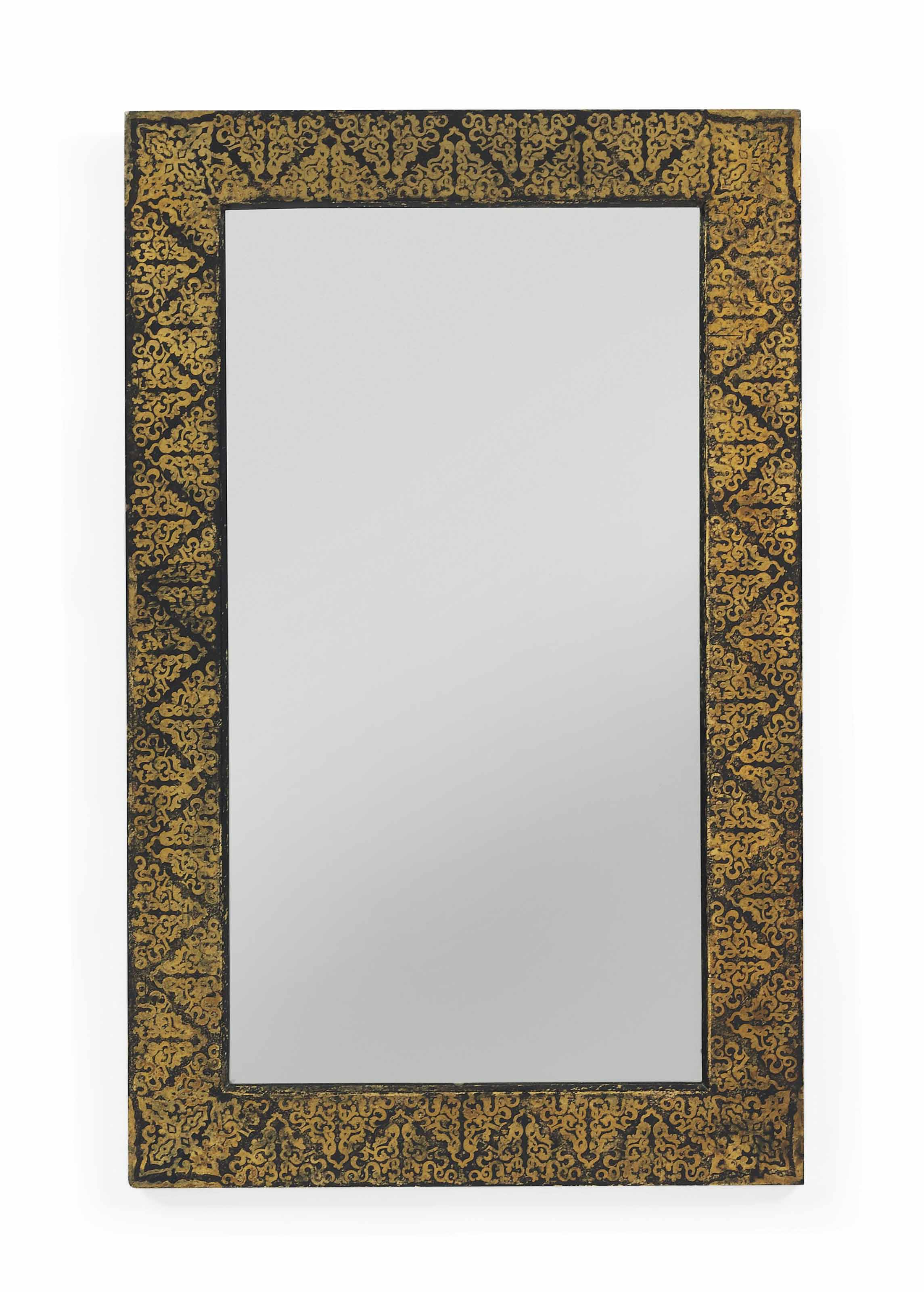 A VICTORIAN PARCEL-GILT AND EBONISED PAPIER-MACHE MIRROR