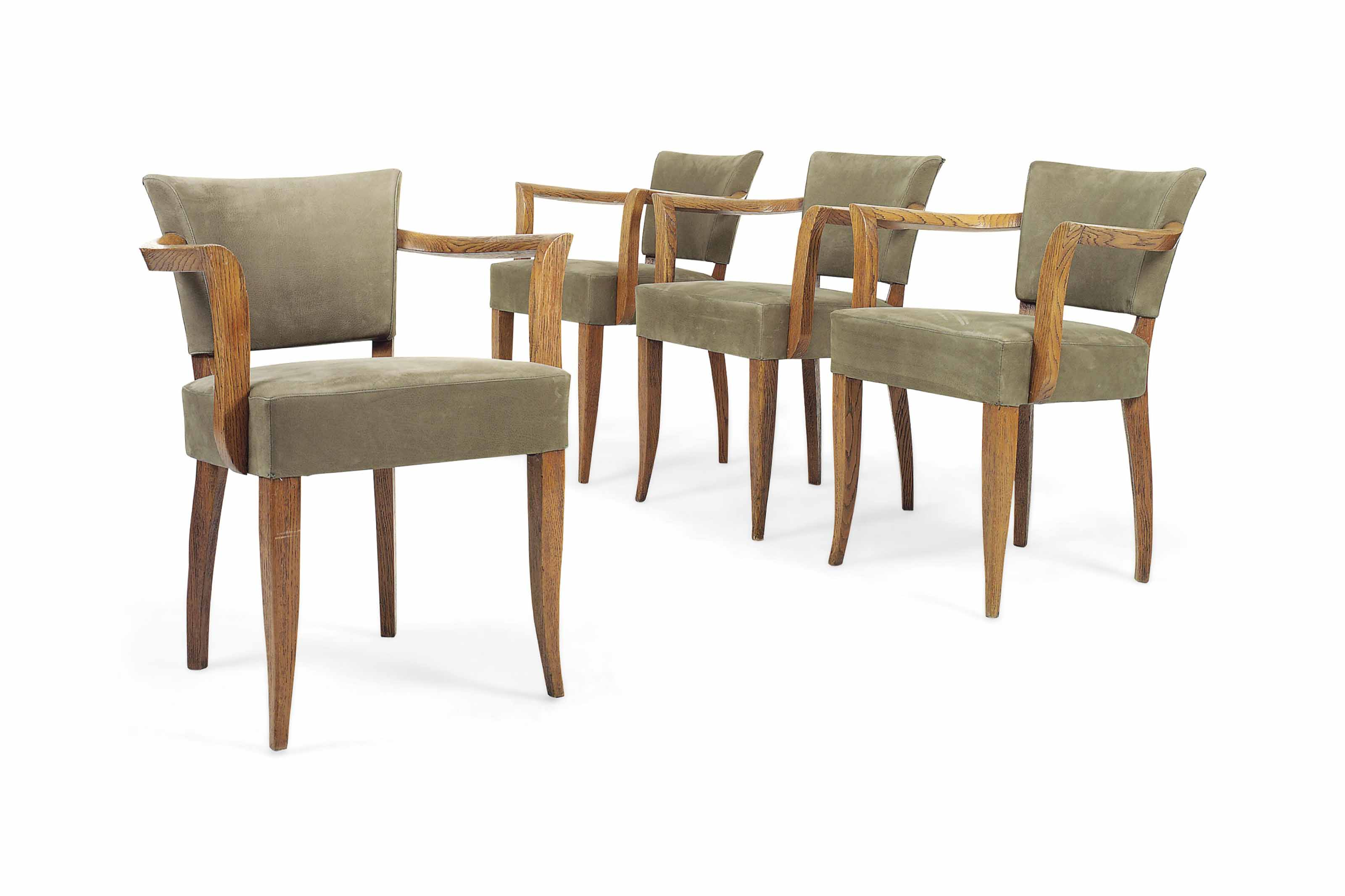 A SET OF FOUR FRENCH OAK ARMCHAIRS