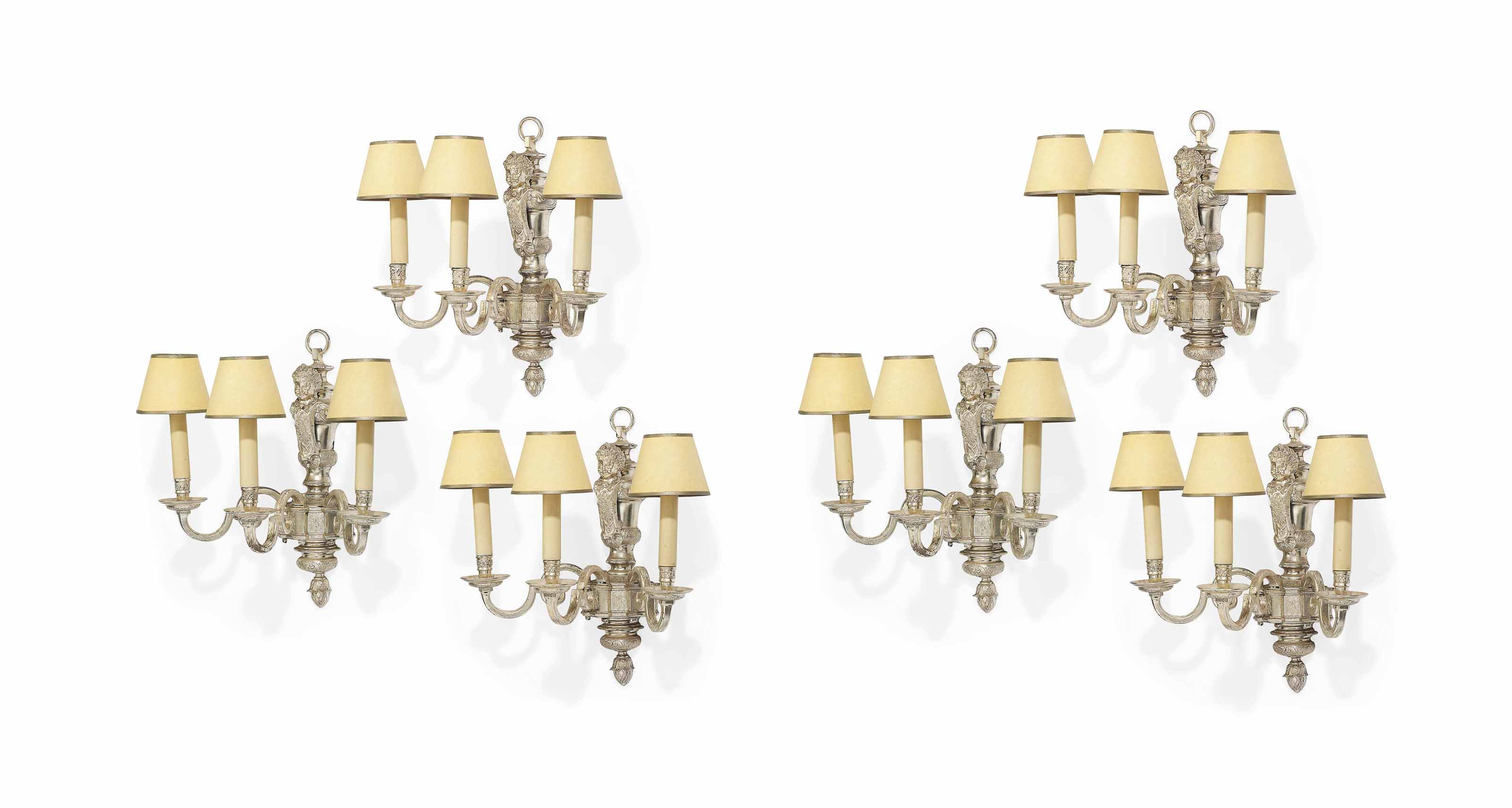 A SET OF SIX CHARLES II-STYLE SILVERED-BRONZE THREE-BRANCH WALL-LIGHTS
