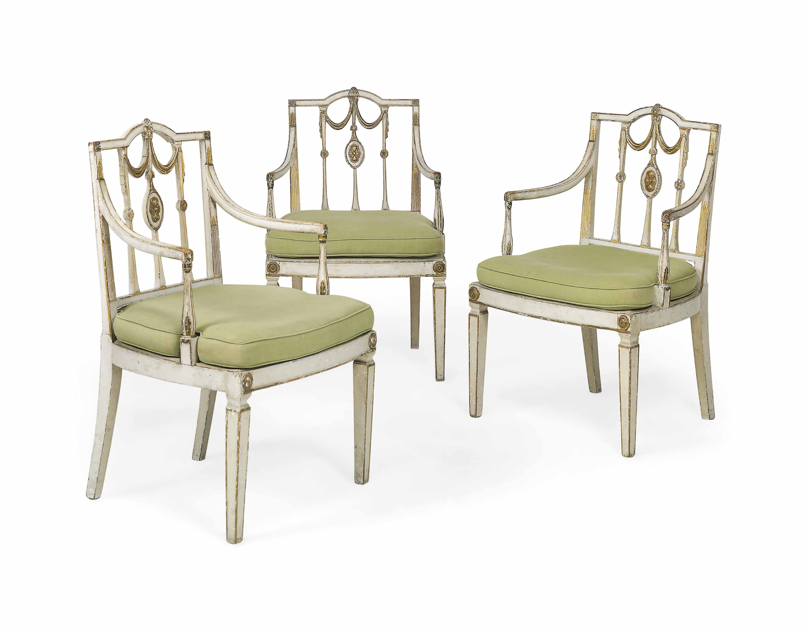A SET OF THREE GEORGE III PARCEL-GILT AND WHITE-PAINTED OPEN ARMCHAIRS