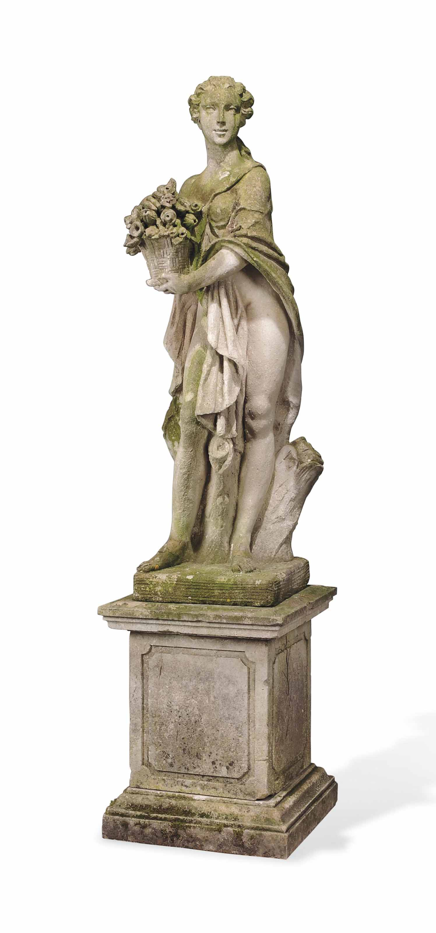 AN ENGLISH COMPOSITE STONE FIGURE OF FLORA
