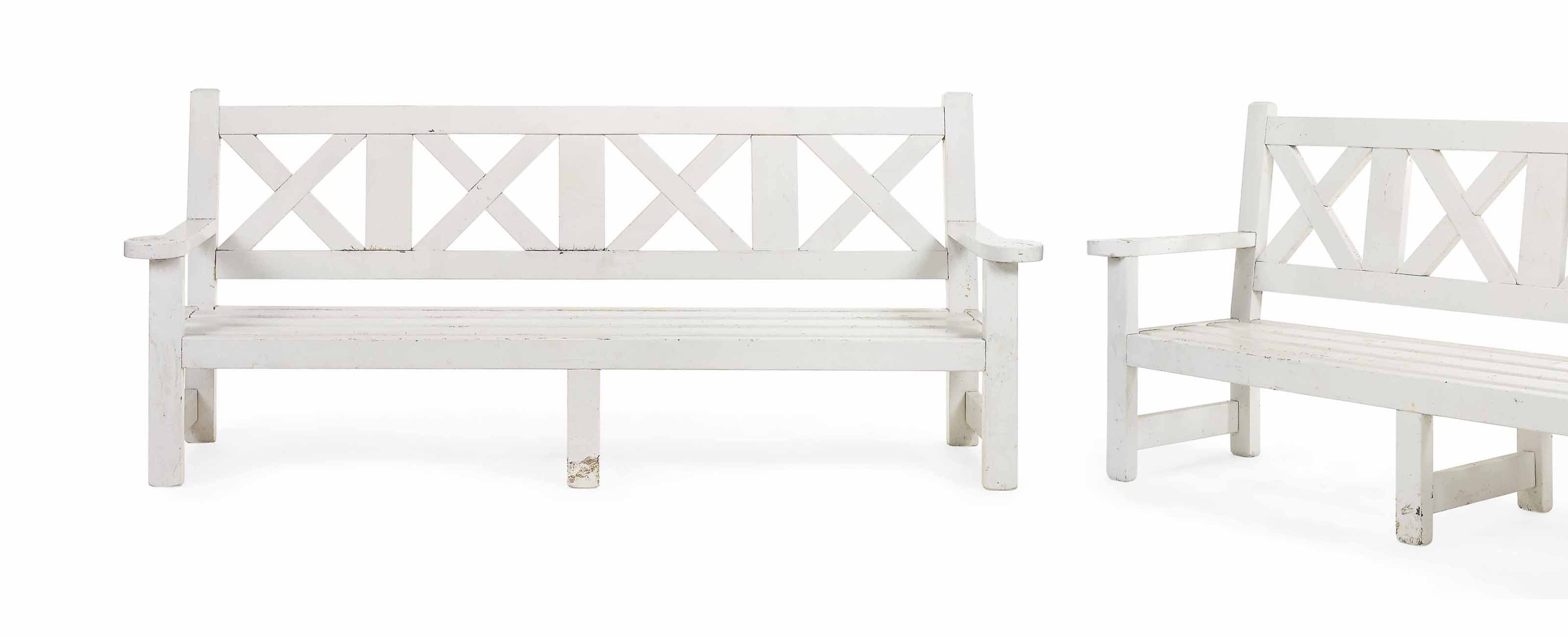 A PAIR OF WHITE-PAINTED LARGE GARDEN BENCHES