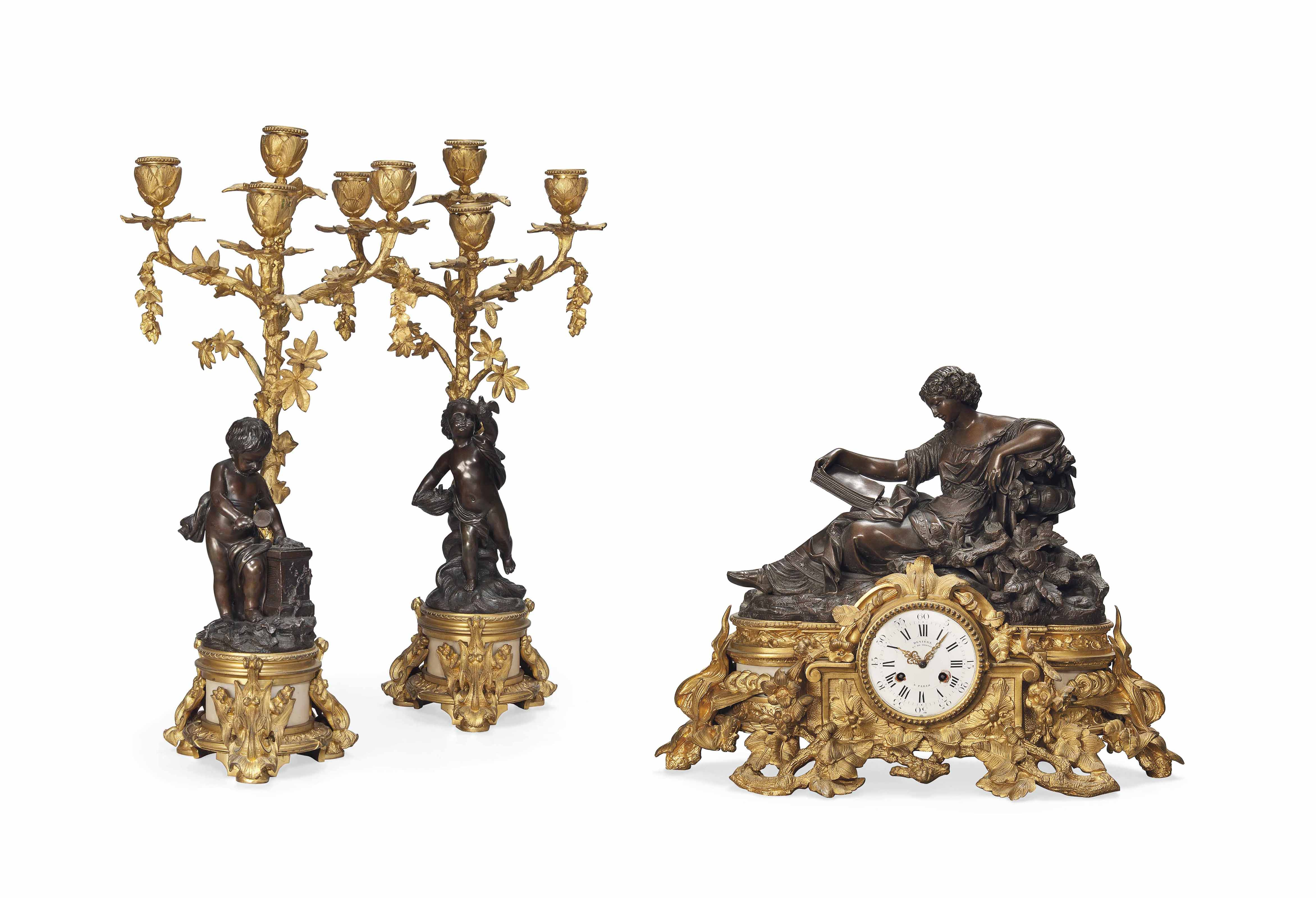 A FRENCH THREE-PIECE GILT AND PATINATED BRONZE AND MARBLE CLOCK GARNITURE