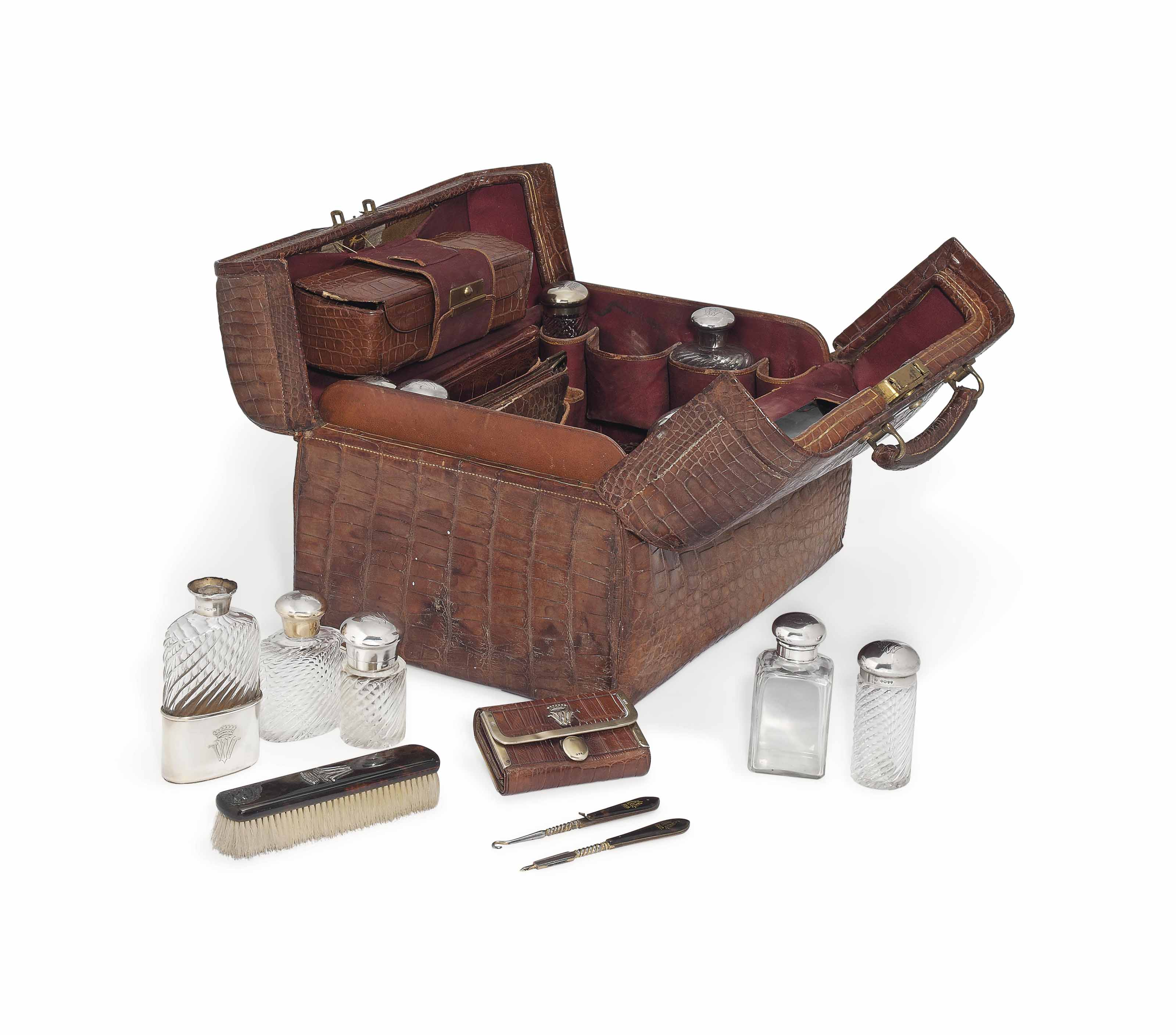 A VICTORIAN GENTLEMAN'S SILVER-GILT AND SILVER-MOUNTED TRAVELLING DRESSING TABLE SET