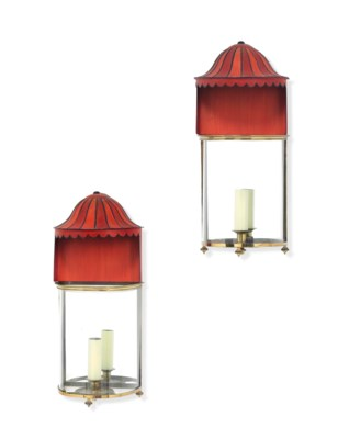 A PAIR OF BRASS AND RED-PAINTE