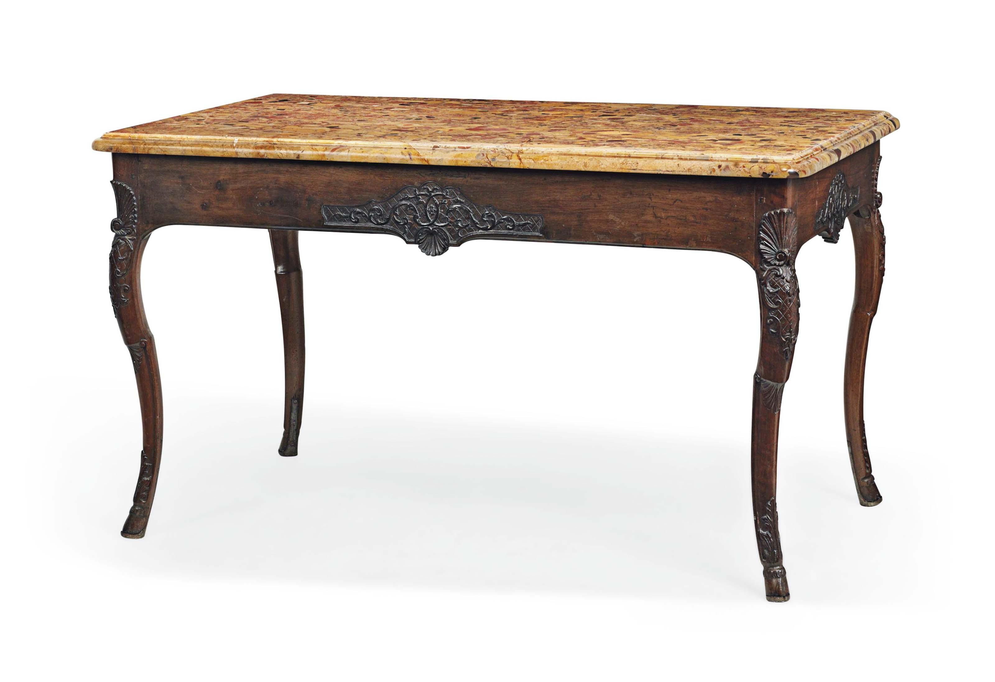 A REGENCE WALNUT CENTRE TABLE