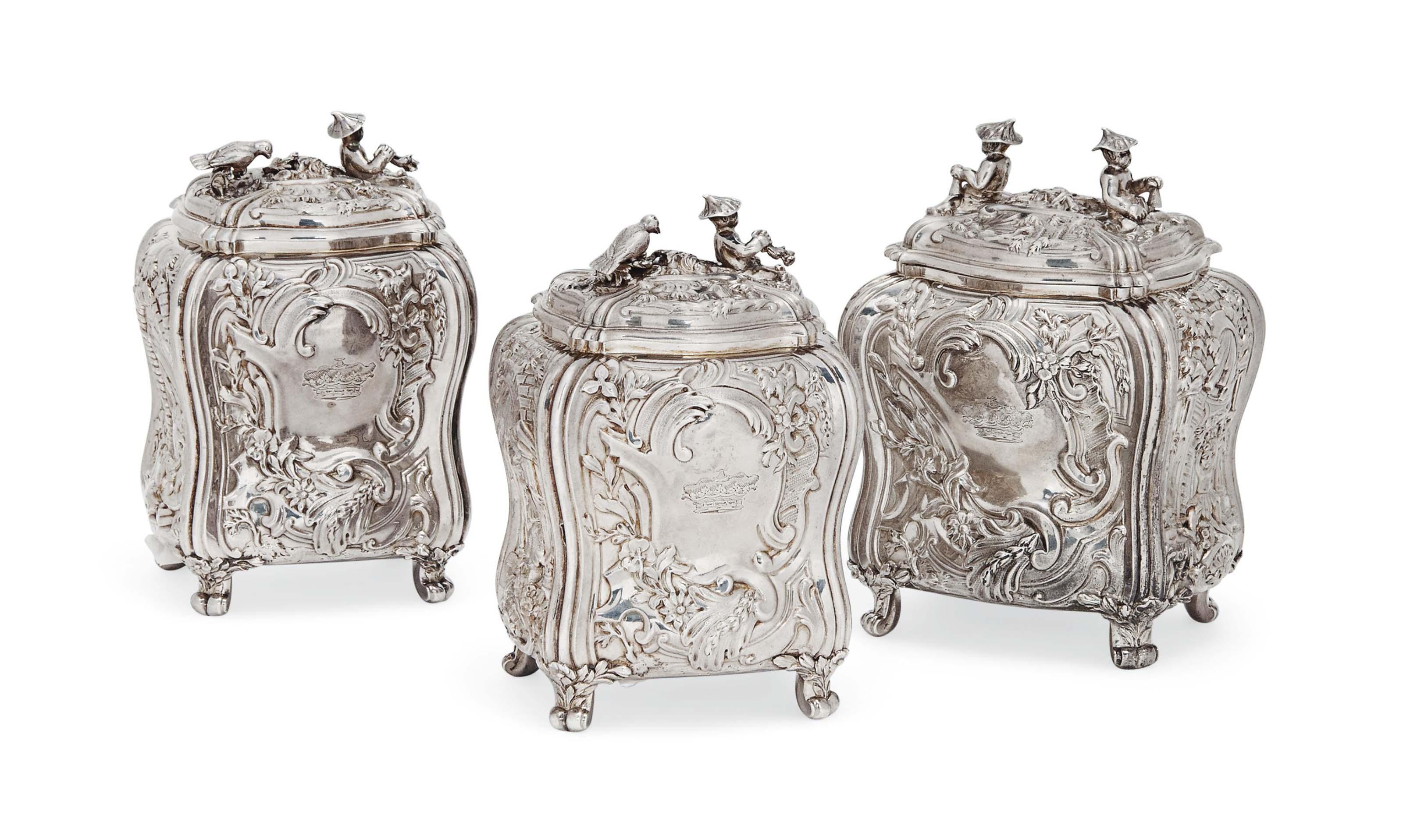 A MATCHING SET OF THREE GEORGE III ROCOCO SILVER TEA CADDIES