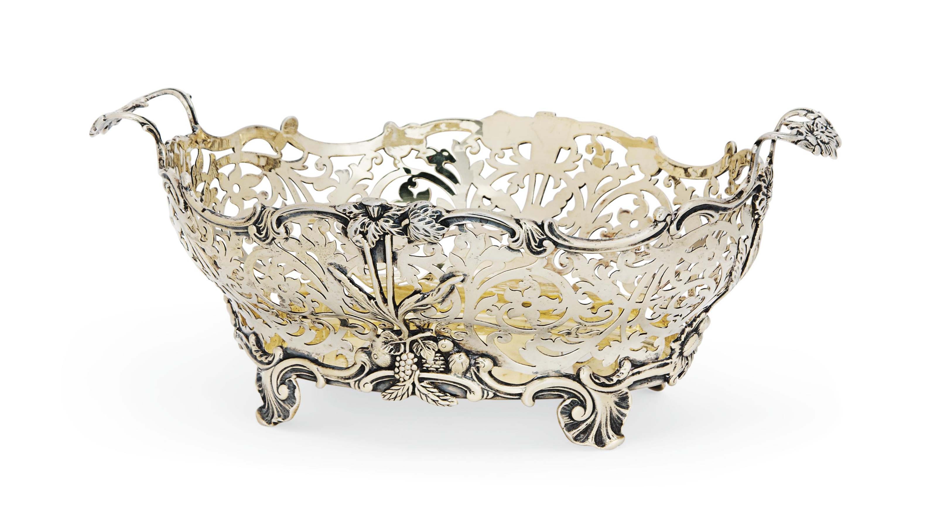 A LATE VICTORIAN SILVER-GILT TWO-HANDLED FRUIT BASKET