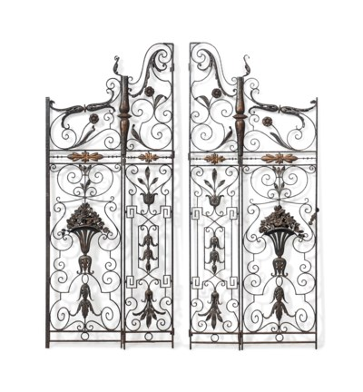 A PAIR OF PARCEL-GILT WROUGHT-