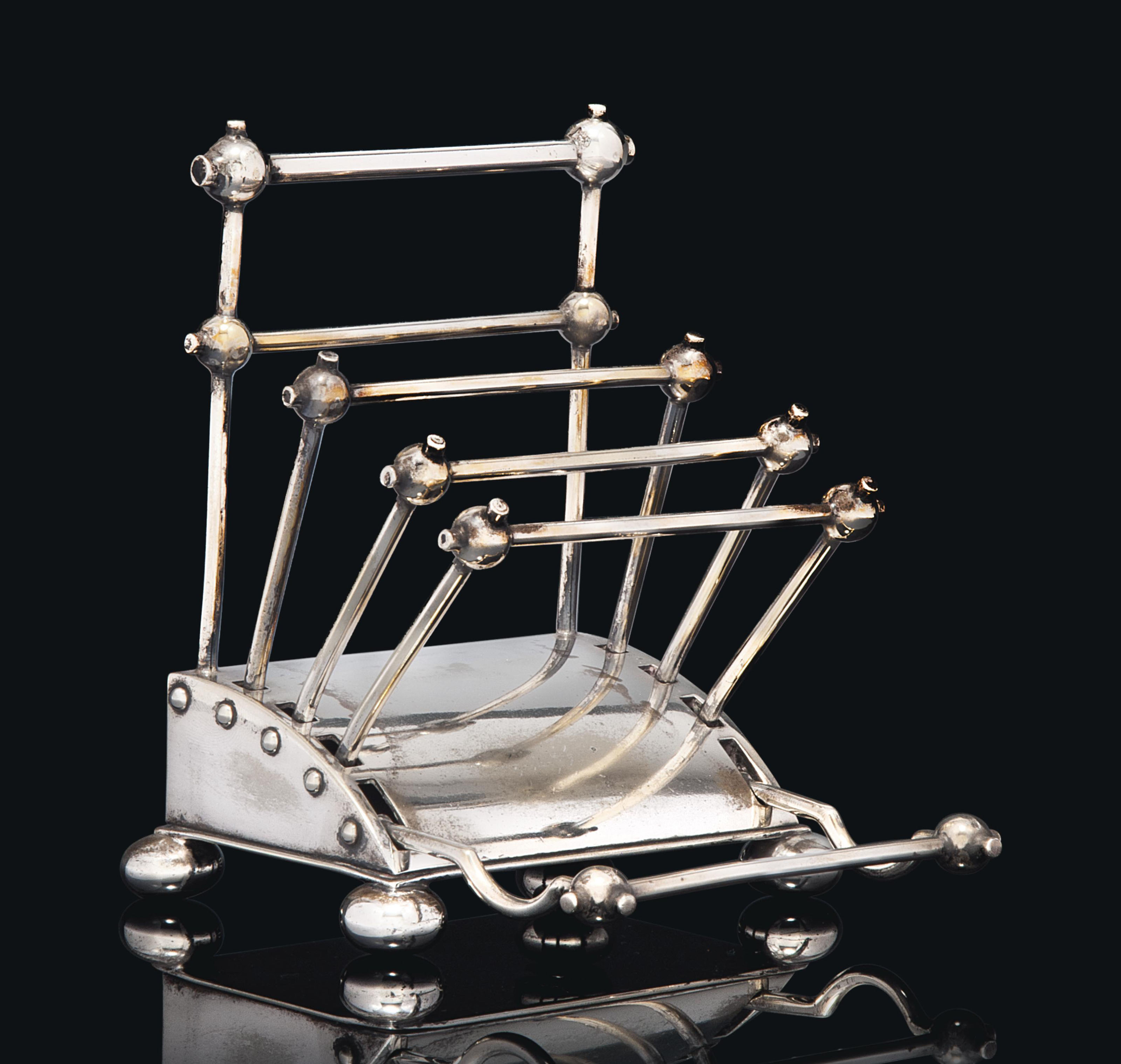 A CHRISTOPHER DRESSER (1834-1904) SILVER-PLATED ARTICULATED HALF-LETTER RACK AND PEN HOLDER MADE BY HUKIN & HEATH