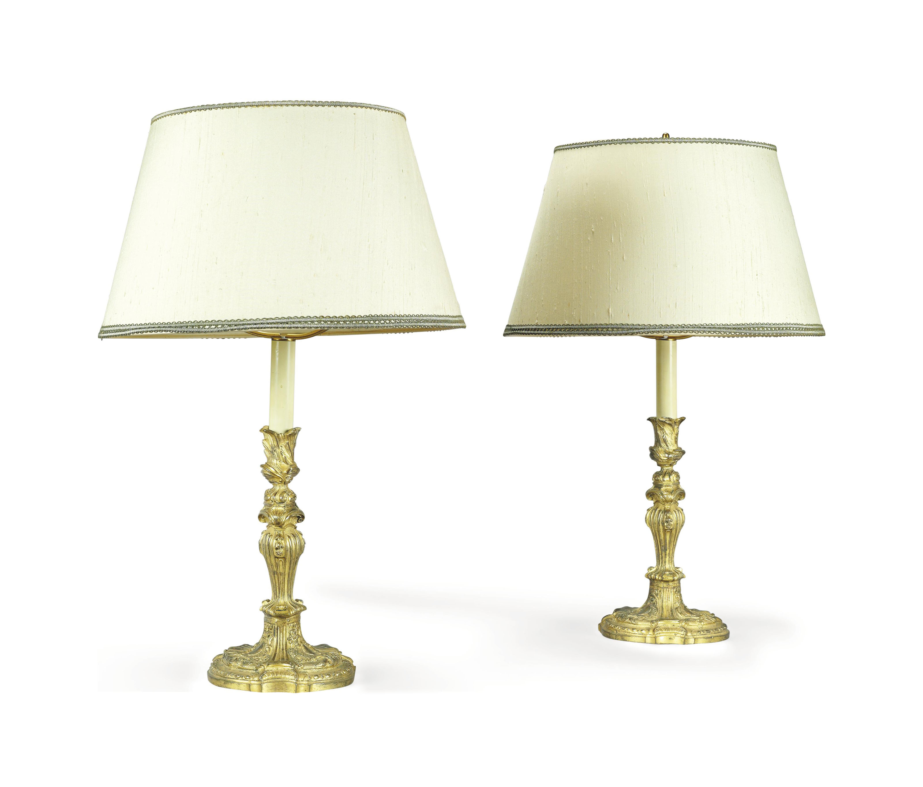 A PAIR OF REGENCE ORMOLU CANDLESTICKS MOUNTED AS TABLE LAMPS