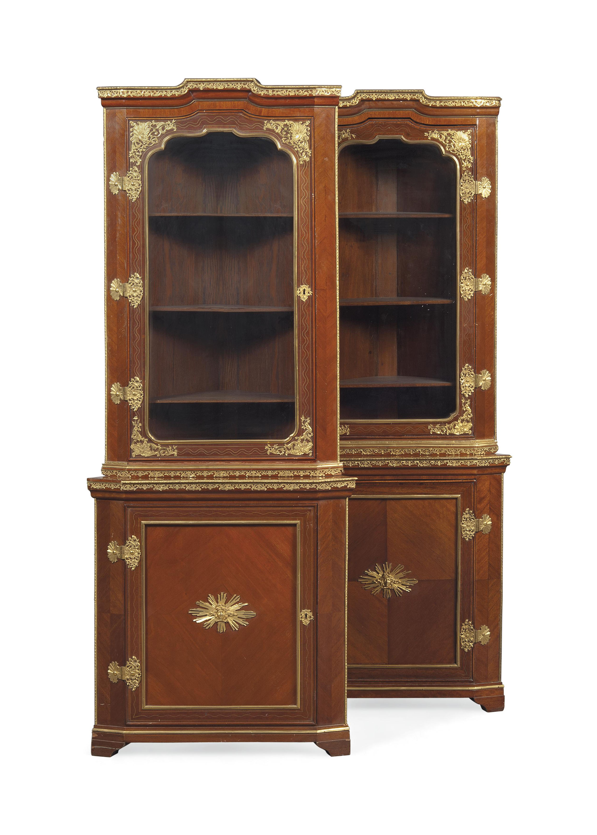 A PAIR OF GERMAN ORMOLU-MOUNTED AND BRASS-INLAID MAHOGANY AND AMARANTH CORNER CUPBOARDS