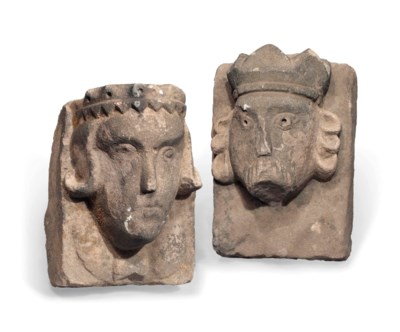A PAIR OF STONE HEADS OF A KIN