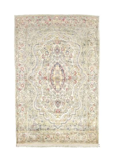 An extremely fine silk Qum rug