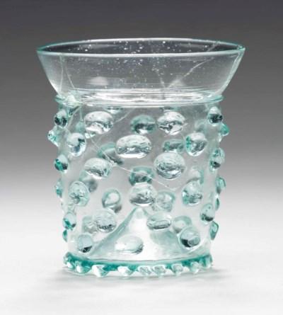 A MEDIEVAL GLASS BEAKER (NUPPE