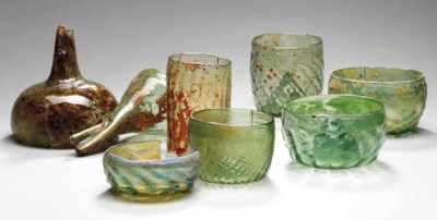 SIX MEDIEVAL GLASS BEAKERS AND