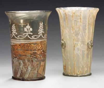 AN ENAMELLED GLASS BEAKER AND
