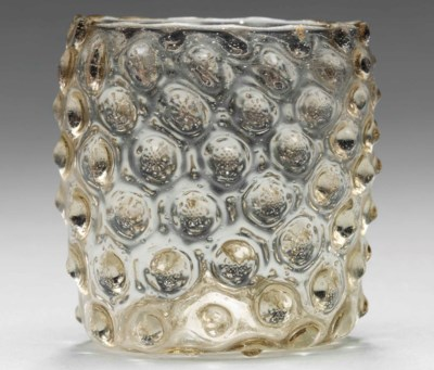 A SMALL MOULDED GLASS BEAKER (