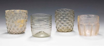 FOUR MOULDED GLASS BEAKERS
