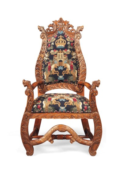 A FLEMISH CARVED PINE ARMCHAIR