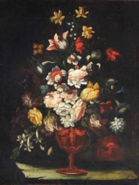 Roses, tulips, poppies and other flowers in an urn on a stone ledge