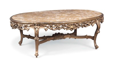 A FRENCH CARVED GILTWOOD LOW T