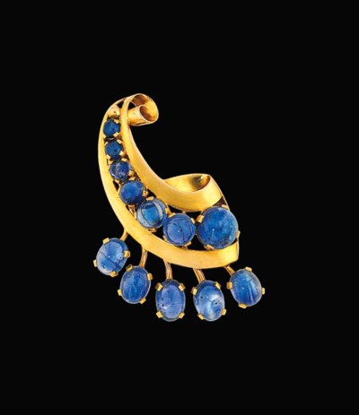 A gold and sapphire clip brooc