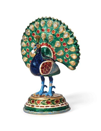 A ENAMELLED GOLD FIGURE OF A P