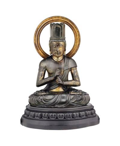 A Fine Seated Bronze Figure of