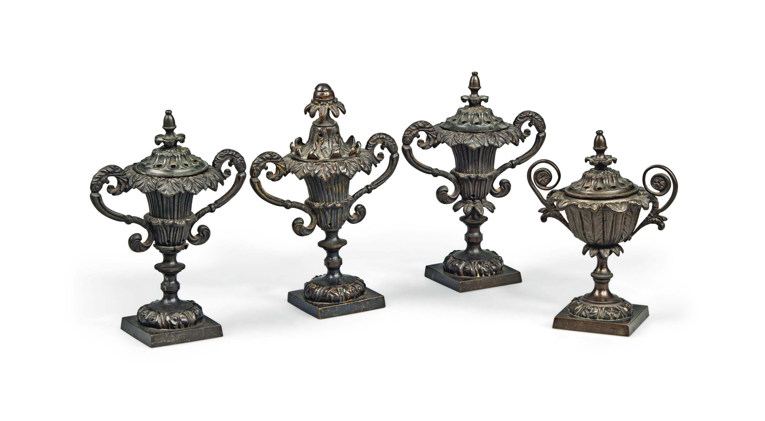 A GROUP OF FOUR REGENCY BRONZE