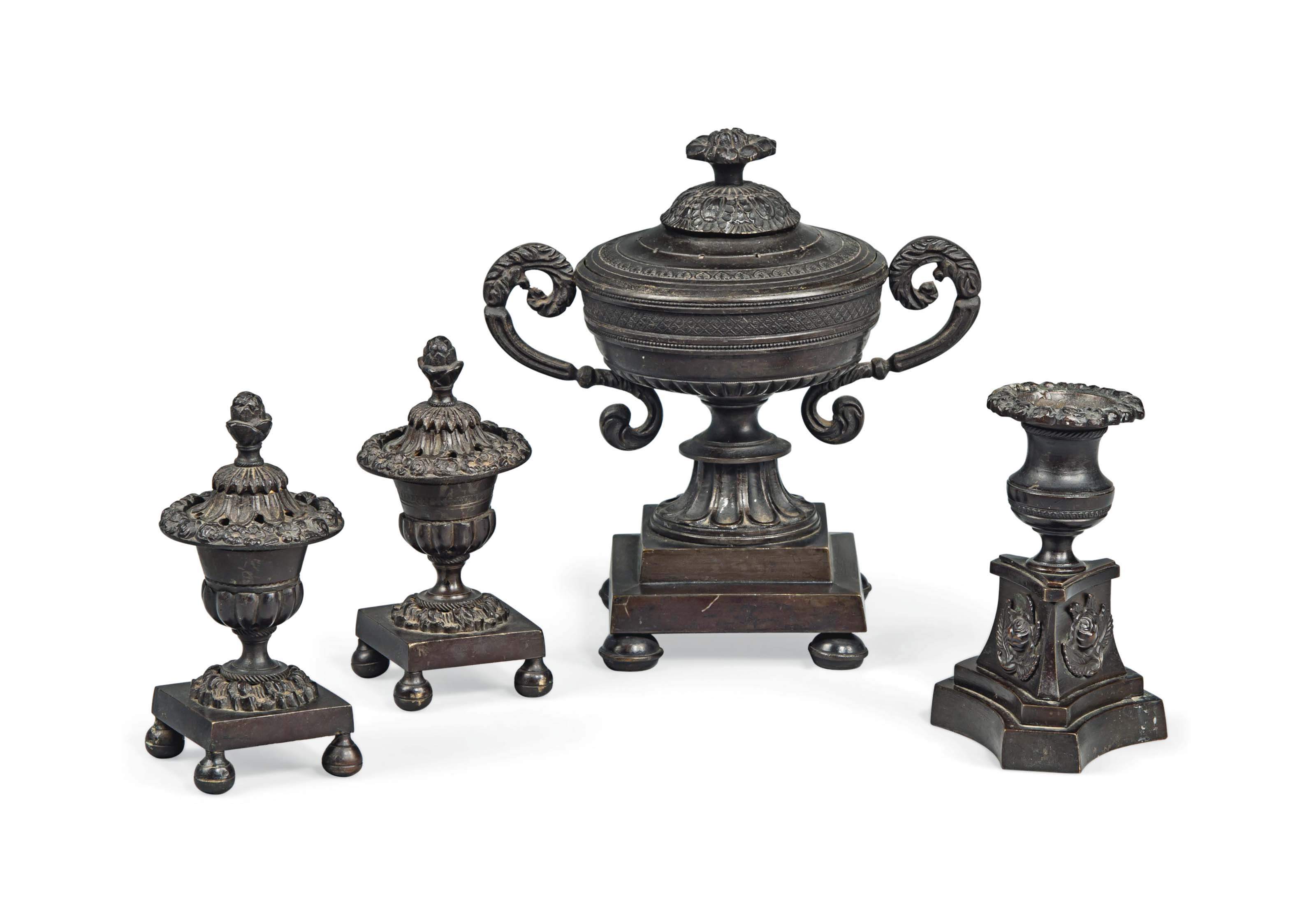 A GROUP OF FOUR BRONZE REGENCY