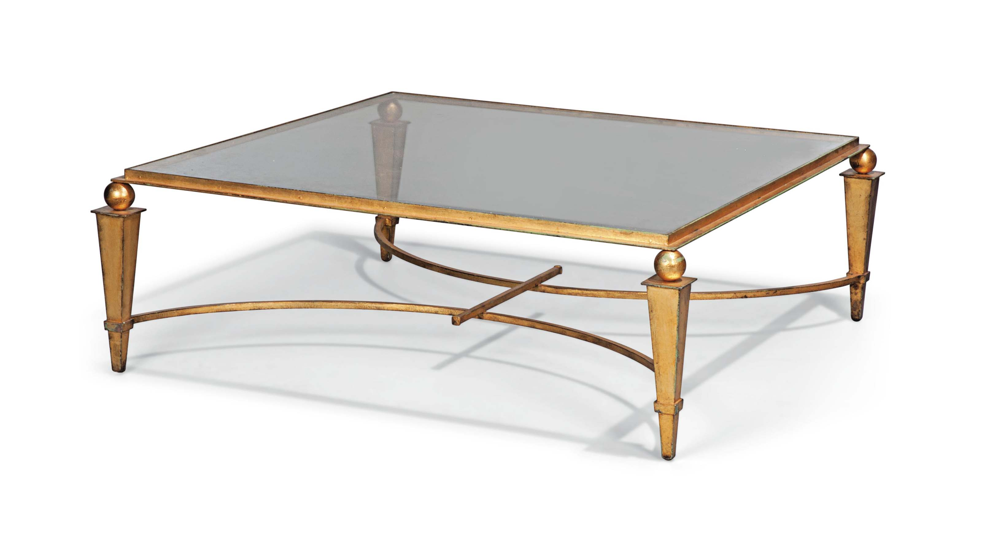 A LARGE GILT-METAL LOW TABLE