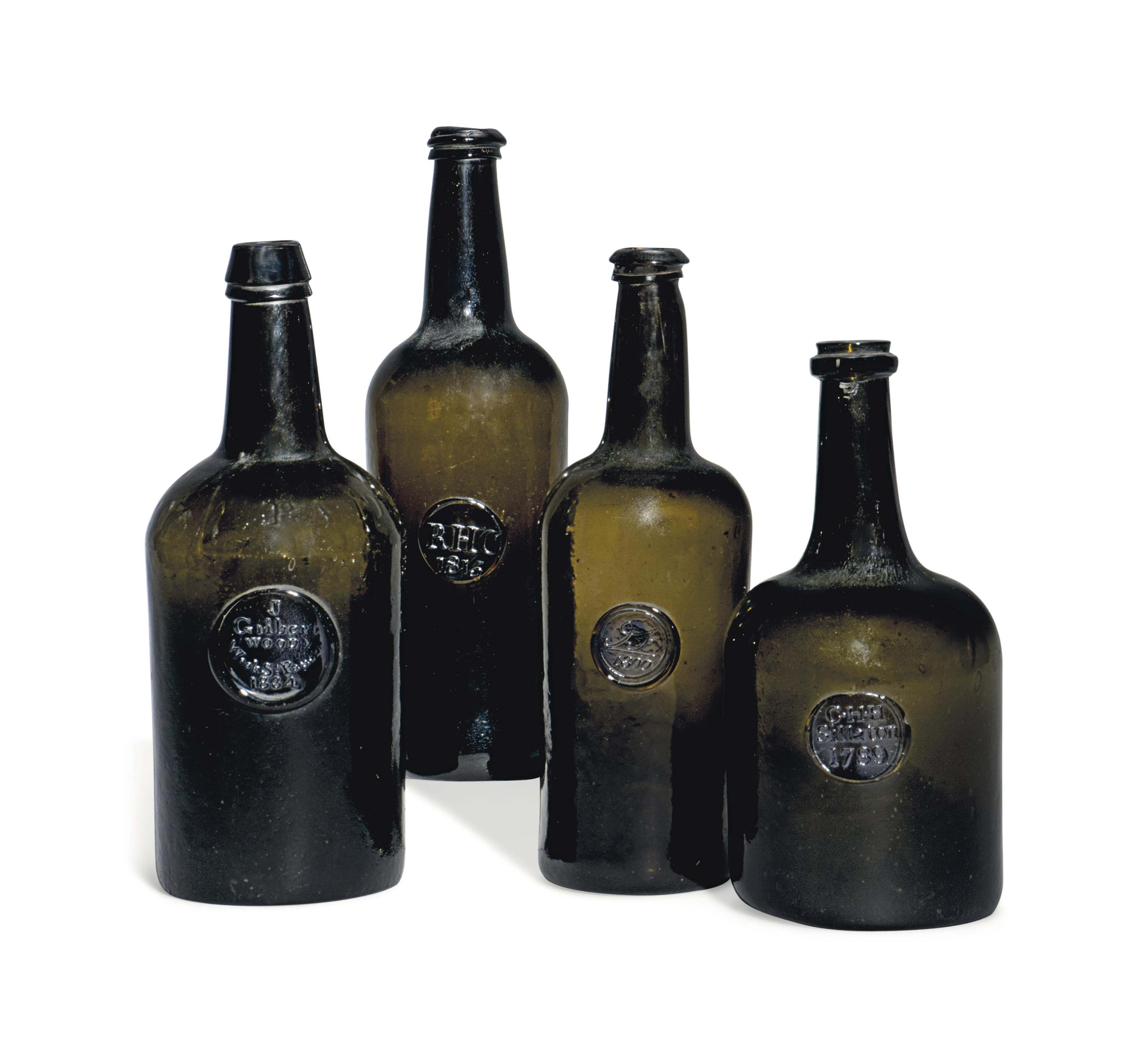 FOUR ENGLISH GLASS SEALED WINE