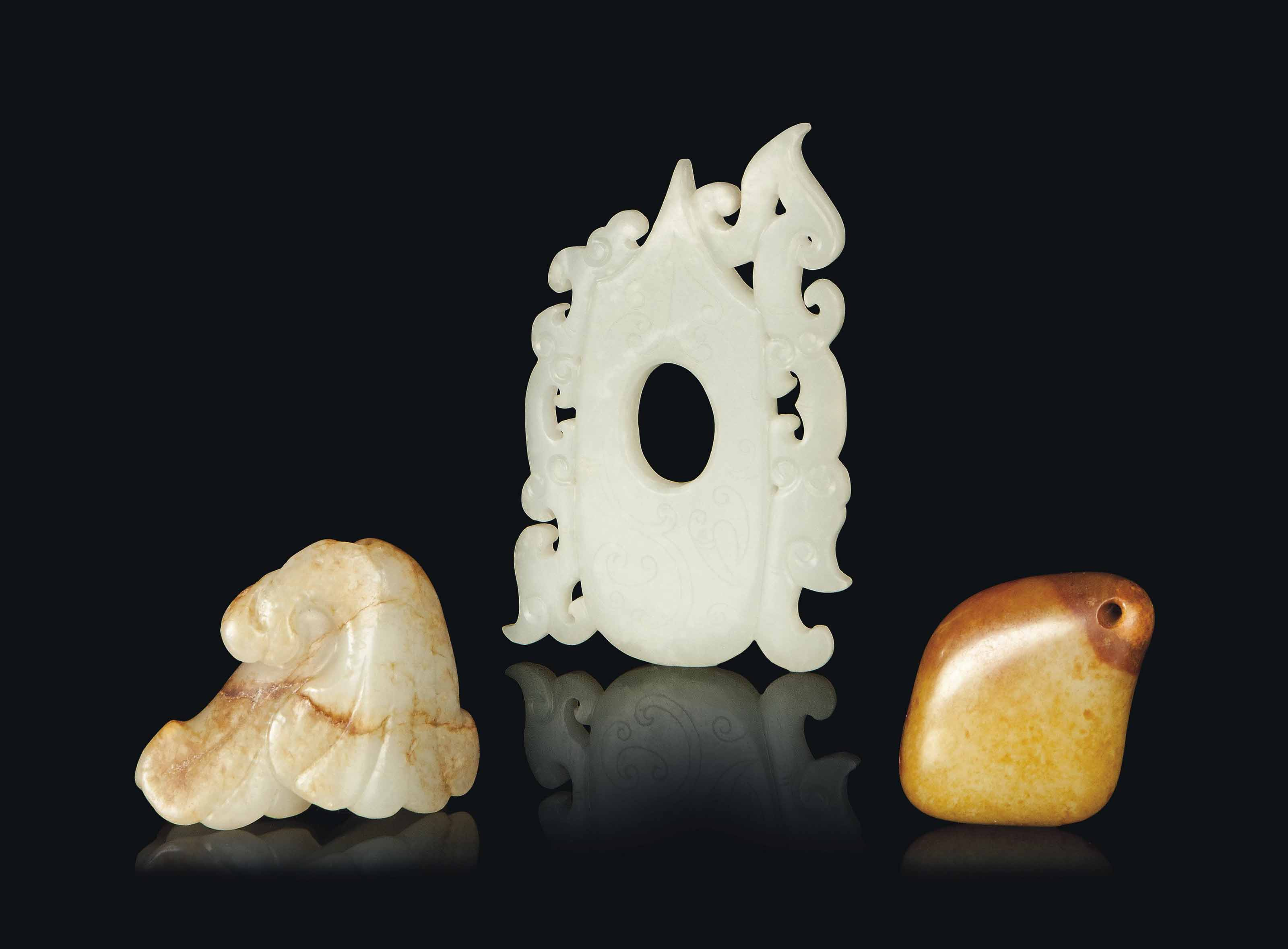 TWO CHINESE JADE PENDANTS AND