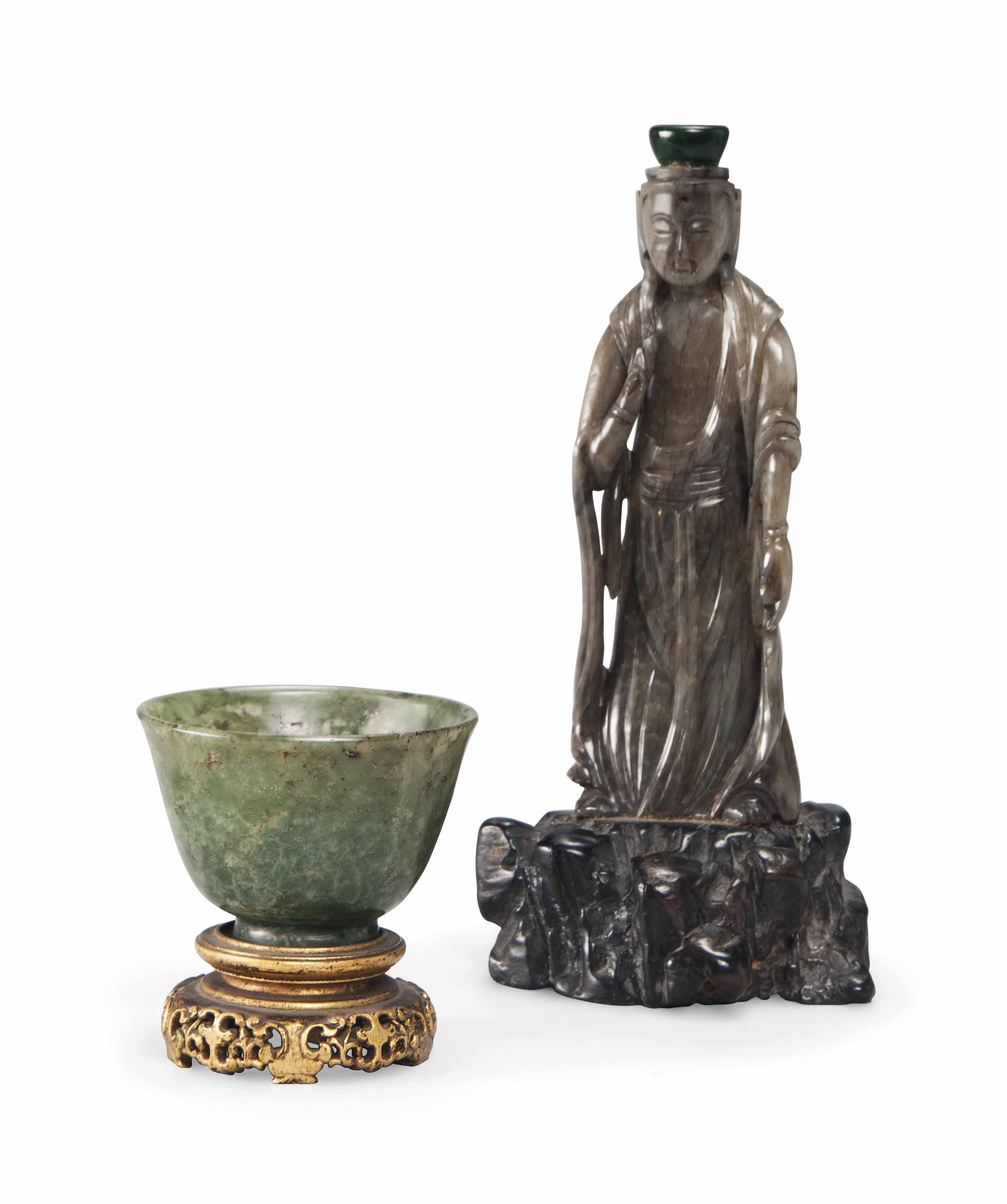 A CHINESE GREY JADE MODEL OF G