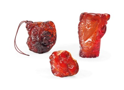 THREE CHINESE AMBER CARVINGS